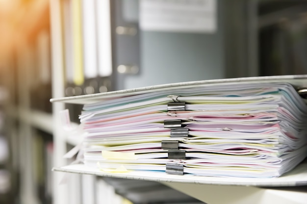 Documents stack in a folder.