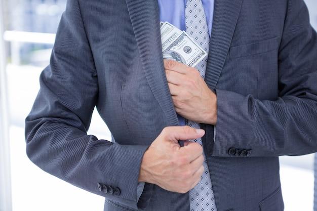 Dodgy businessman with dollar bills