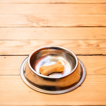 Dog food bowl with bone