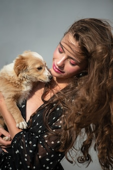 Dog pet. cute puppy with beauty woman. high fashion model girl hugging with pup.