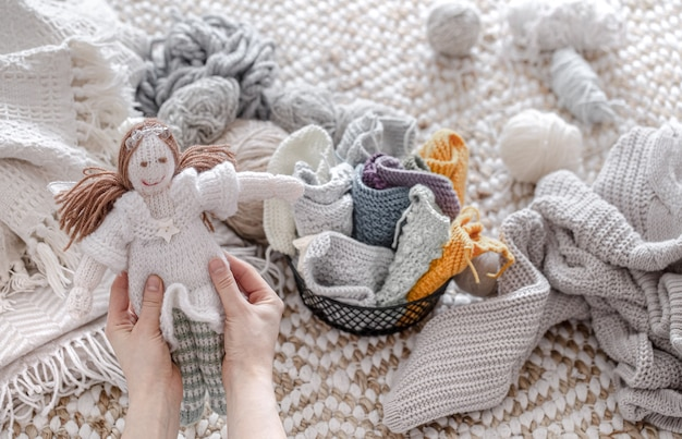 A doll made of knitted elements, threads and yarn.
