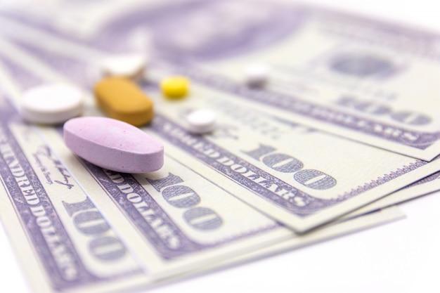 Dollar bank and medicine capsules