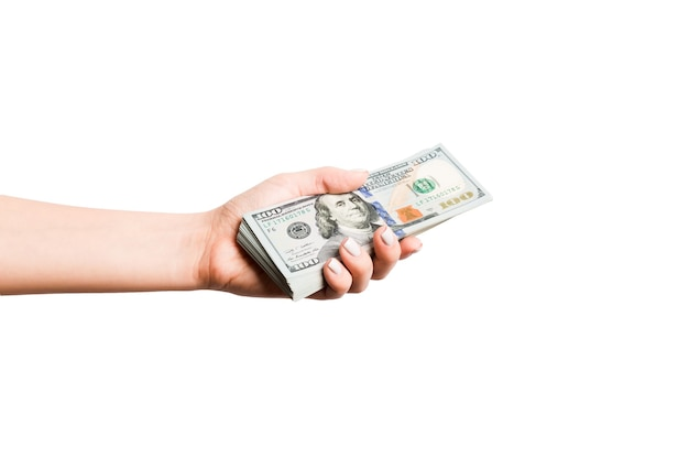Dollar banknotes in female hand on white isolated surface. business concept.