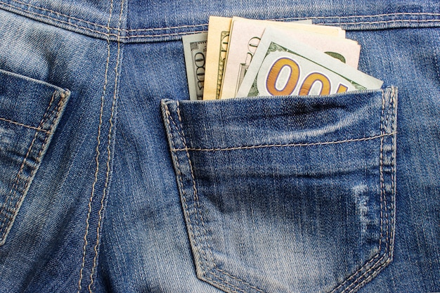 Dollar banknotes in jeans pocket closeup. business concept. pocket money.