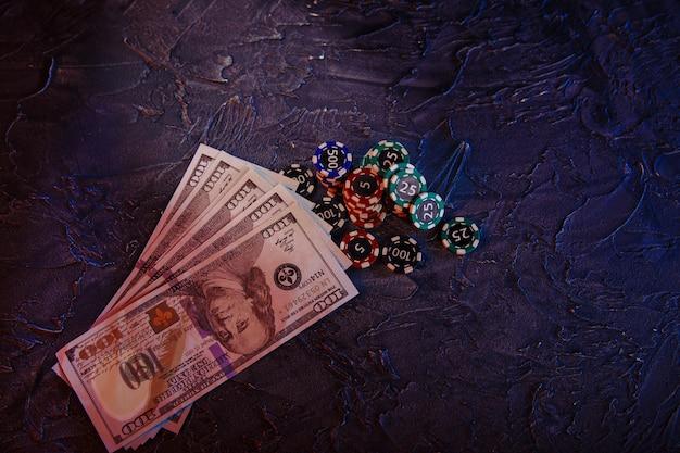Dollar banknotes and stacks of gambling chips.