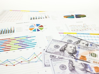 Dollar banknotes with business graphs and report information