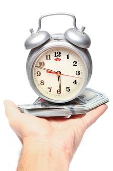 Доллар бизнес деньги с часами в руке на белом фоне