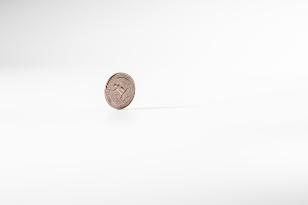 Dollar coin rotating on white background, concept of american economy.