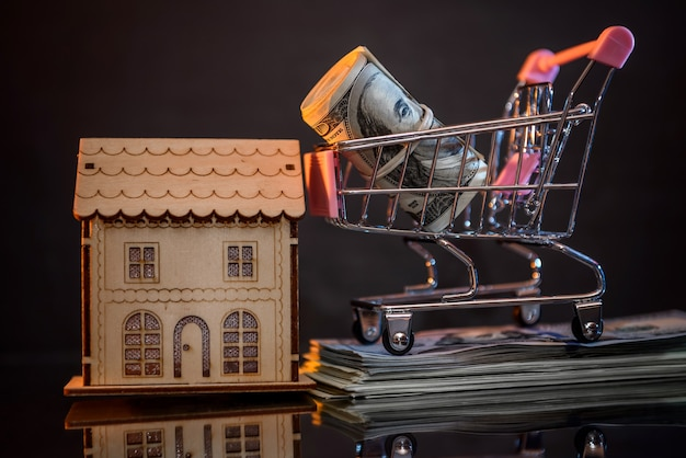 Dollar roll in toy cart at dark background