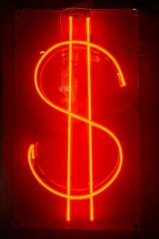 Знак доллара в неоне. неоновая аббревиатура американского доллара. киберпанк неоновый минимальный