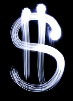 Символ доллара, сделанный в технике фото световой живописи изолирован