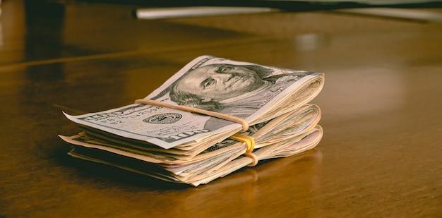 Dollar  usd us dollar bills on a wooden table