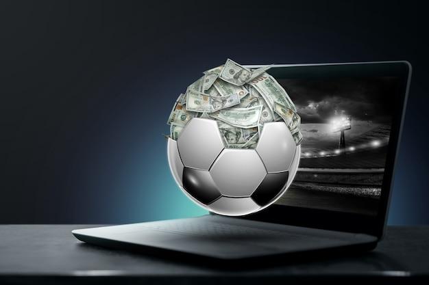 Доллары внутри футбольного мяча, мяч полон денег. ставки на спорт, ставки на футбол, азартные игры, букмекерская контора, крупный выигрыш.