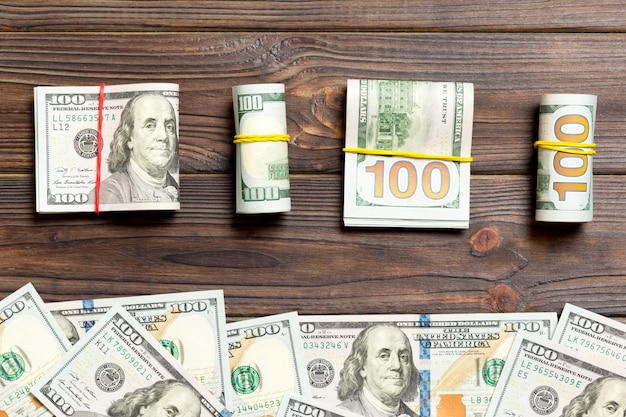 Dollars currency on wooden background