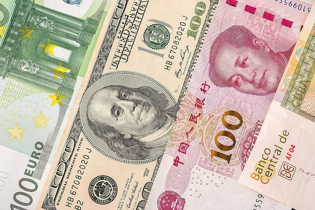 Dollars, euro and yuan closeup