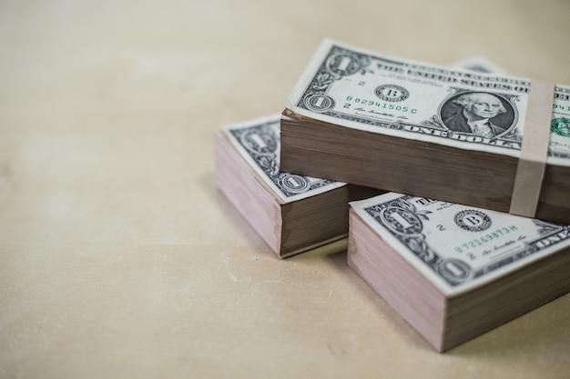 Dollars money on wood texture