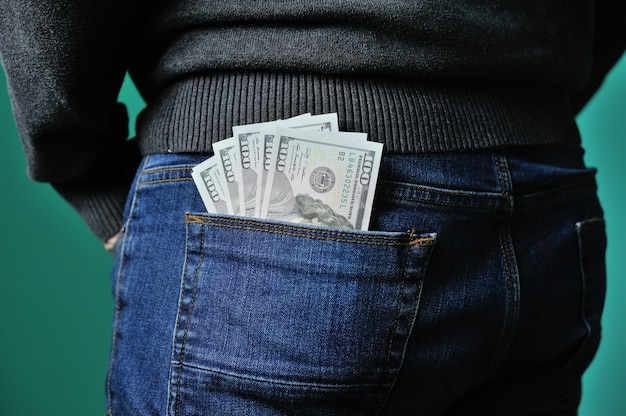 Dollars in the pocket of jeans bundle of dollars money in the pocket of trousers