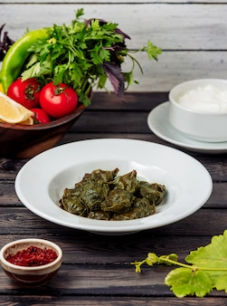 Dolma from grape leaves on the table