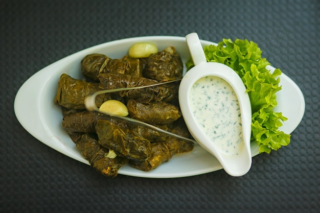 Dolma. matsoni white sauce with garlic and herbs.