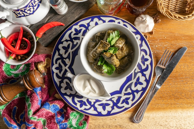 Dolma. traditional oriental hot dish of minced lamb in pickled grape leaves with garlic matzoni sauce