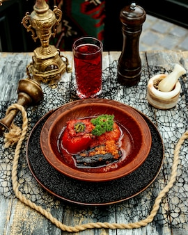 Dolma with stuffed meat in baked tomato and eggplant