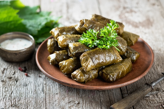 Dolma on a wooden rustic background. traditional caucasian, turkish and greek cuisine