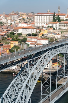 Dom luis i bridge view with subway train track and tourists