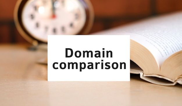 Domain comparison text on a white book and clock