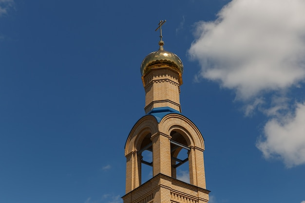 Dome of the christian church against the background of a sky.