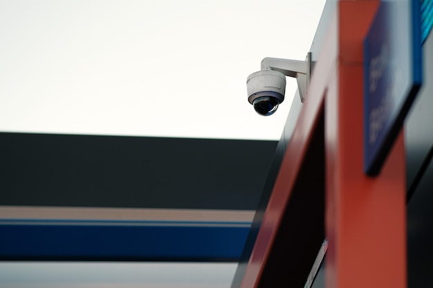 Dome video surveillance camera on the facade of the building. the concept of a centralized security system. face recognition, search for criminals.