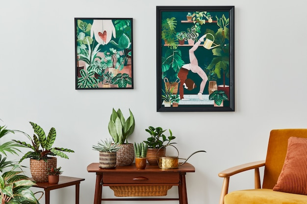 Domestic interior of living room with vintage retro shelf, a lot of house plants, cacti, wooden mock up poster frame on the white wall and elegant accessories at stylish home garden