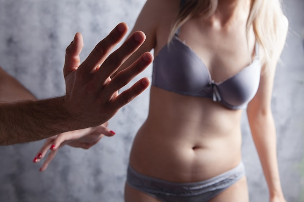 Domestic violence against a girl in underwear