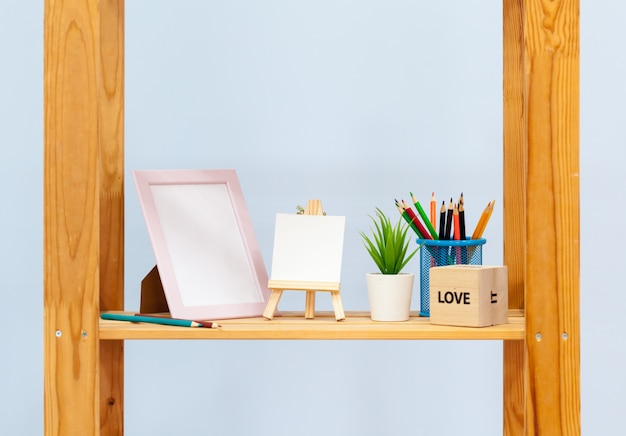 Domestic wooden shelf with stationery close up