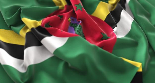 Dominica flag ruffled beautifully waving macro close-up shot