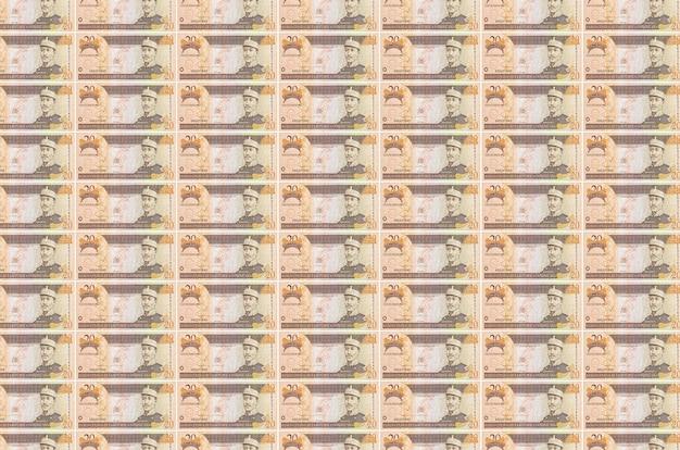 お金の生産コンベヤーで印刷されたドミニカペソ紙幣