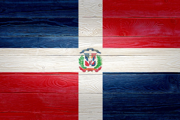 Dominican republic flag painted on old wood plank background
