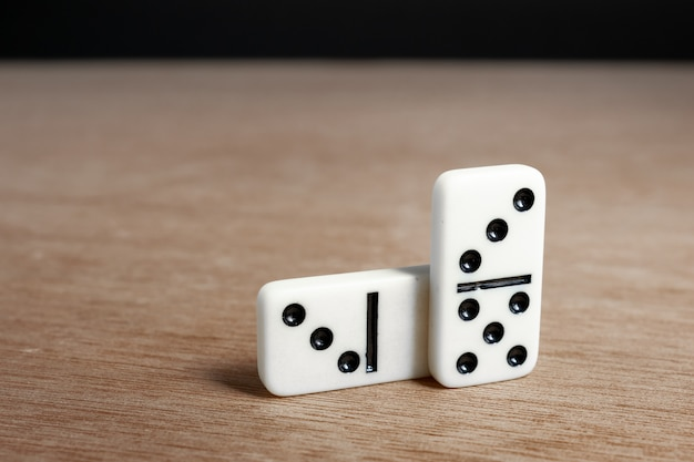 Domino chips with wooden background