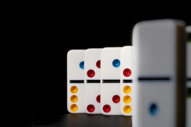 Domino game. dominoes on a black table