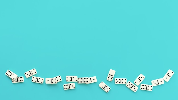 Domino pieces on a pale blue background