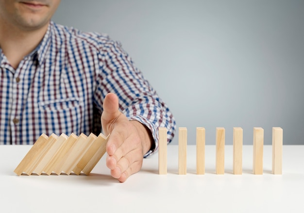 Domino wooden blocks paused from falling