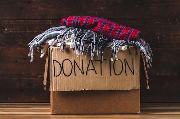 Donation concept. donation box with donation clothes. charity. help for people in need