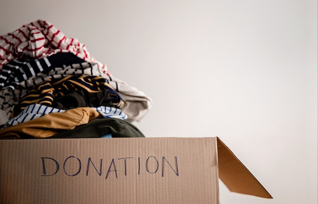 Donation concept. preparing used old clothes into a donate box
