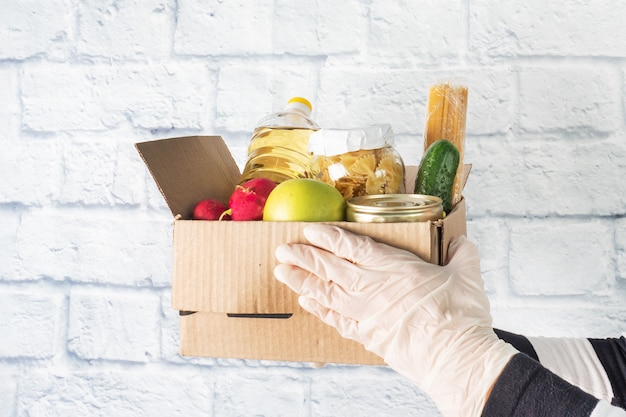 Donation of food collected in a box. copy space.