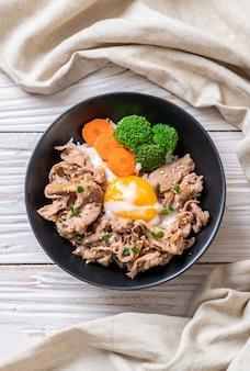 Donburi, pork rice bowl with onsen egg and vegetable