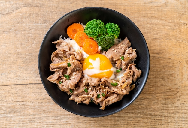Donburi, pork rice bowl with onsen egg and vegetable