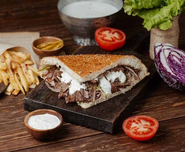 Doner burger in bread with french fries