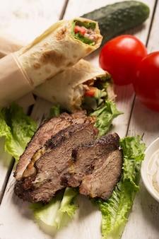 Doner kebab - fried beef meat with vegetables