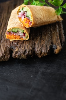 Doner kebab shawarma vegetable pita bread filling vegetables organic dish on the table