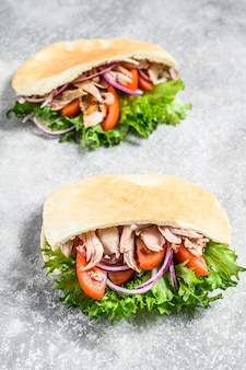 Doner kebab with grilled chicken meat and vegetables in pita bread