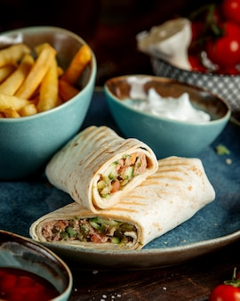 Doner in lavash with fries